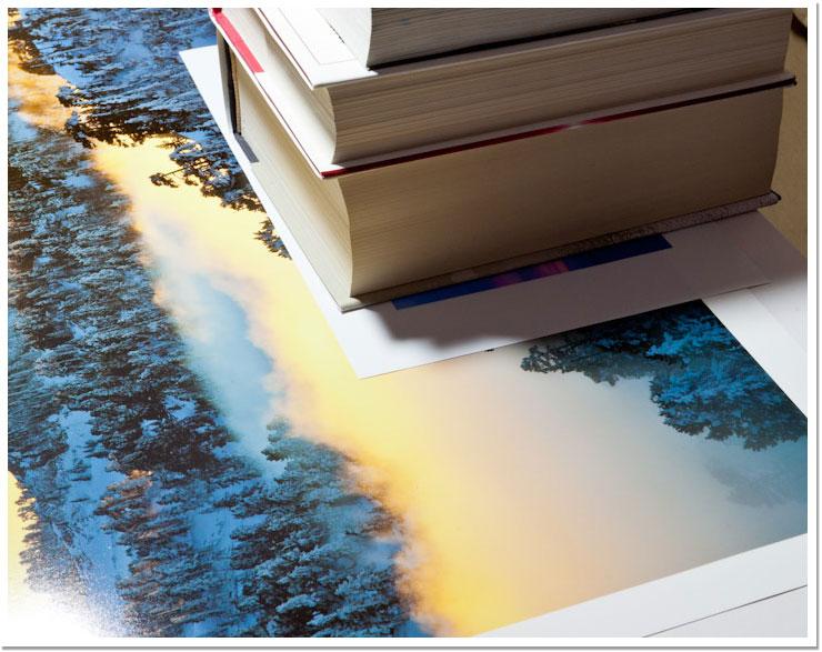 Libros aguantando la foto quietecita en su sitio