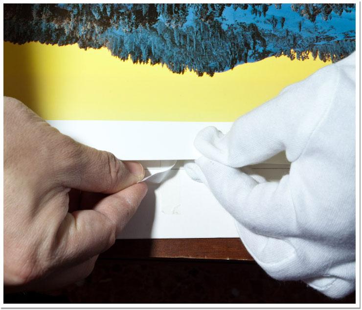 Pegando el borde superior de la imagen a la lámina posterior